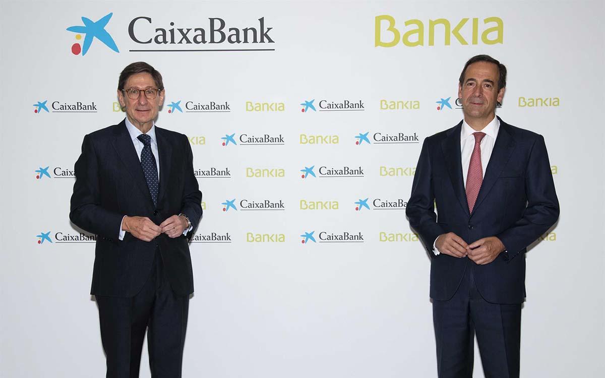 El presidente de Bankia, José Ignacio Goirigolzarri, y el consejero delegado de CaixaBank, Gonzalo Gortázar.